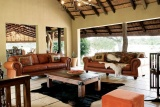 Guest lounge at arathusa safari lodge