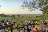 Endless views over the Maasai Mara at Bateleur Camp, Kenya