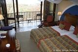 Victoria Falls Safari Lodge bedroom with balcony
