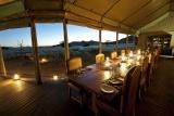 Desert rhino camp lamp-lit dinner mm