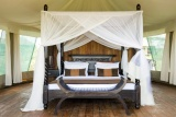 Romantic bedroom at lake masek tented camp