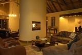 Shishangeni Private Game Lodge lounge with fireplace