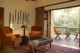 Shishangeni Private Game Lodge bedroom with private patio