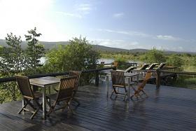 Camp Shawu deck overlooking dam