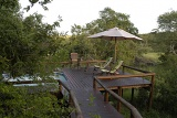Camp Shonga pool area with deck chairs