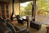 Camp Shonga lounge area with deck overlooking African bushveld