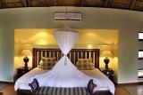 Imbali Safari Lodge bedroom with mosquito net