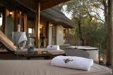 Imbali Safari Lodge patio with comfortable deckchairs