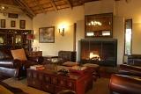 Imbali Safari Lodge lounge area with fireplace