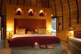 Hoyo Hoyo Tsonga Lodge bedroom with king-size bed