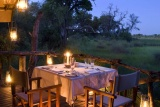 Nxabega okavango tented camp table for two