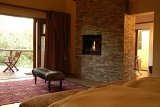 Shishangeni Private Game Lodge bedroom with fireplace