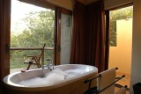 Shishangeni Private Game Lodge en-suite bathroom with view of bushveld