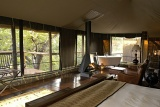 Camp Shonga room with en-suite bathroom and fireplace