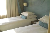Comfortable twin room at Peermont Metcourt
