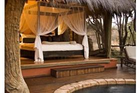 Luxurious safari-style bedroom at Jaci's Safari Lodge, Madikwe Game Reserve