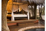 Luxurious safari-style bedroom at Jaci's Safari Lodge, Madikwe Game Reserve