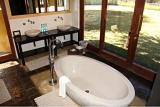 Luxury bath with outdoor views, Tau Game Lodge