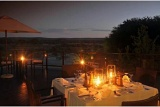 Romantic night-time dining, Tau Game Lodge