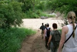 Walking into dry river bed