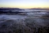 Aerial of the fog covered hoab river dana allen damaraland camp